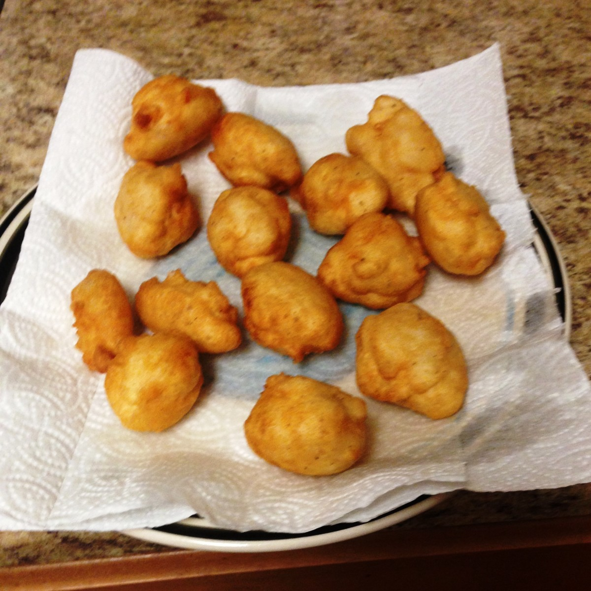 Drain the akara on a paper towel after frying.