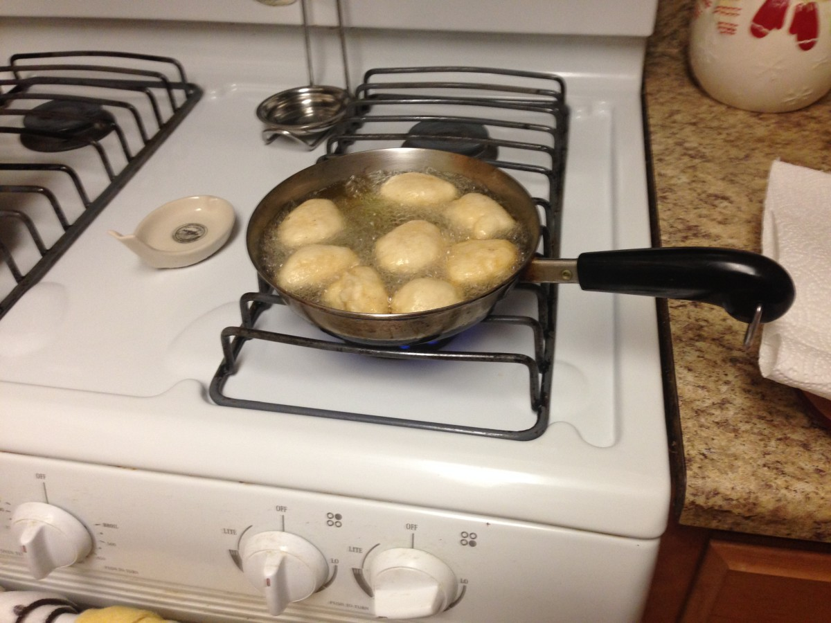 Frying the akara.