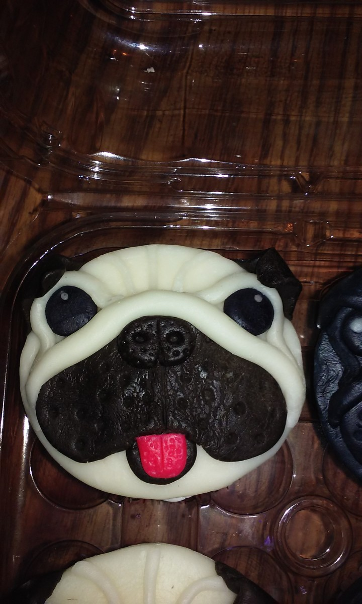 For these pug faces of chocolate, the entire cupcake topper here is modeling chocolate.