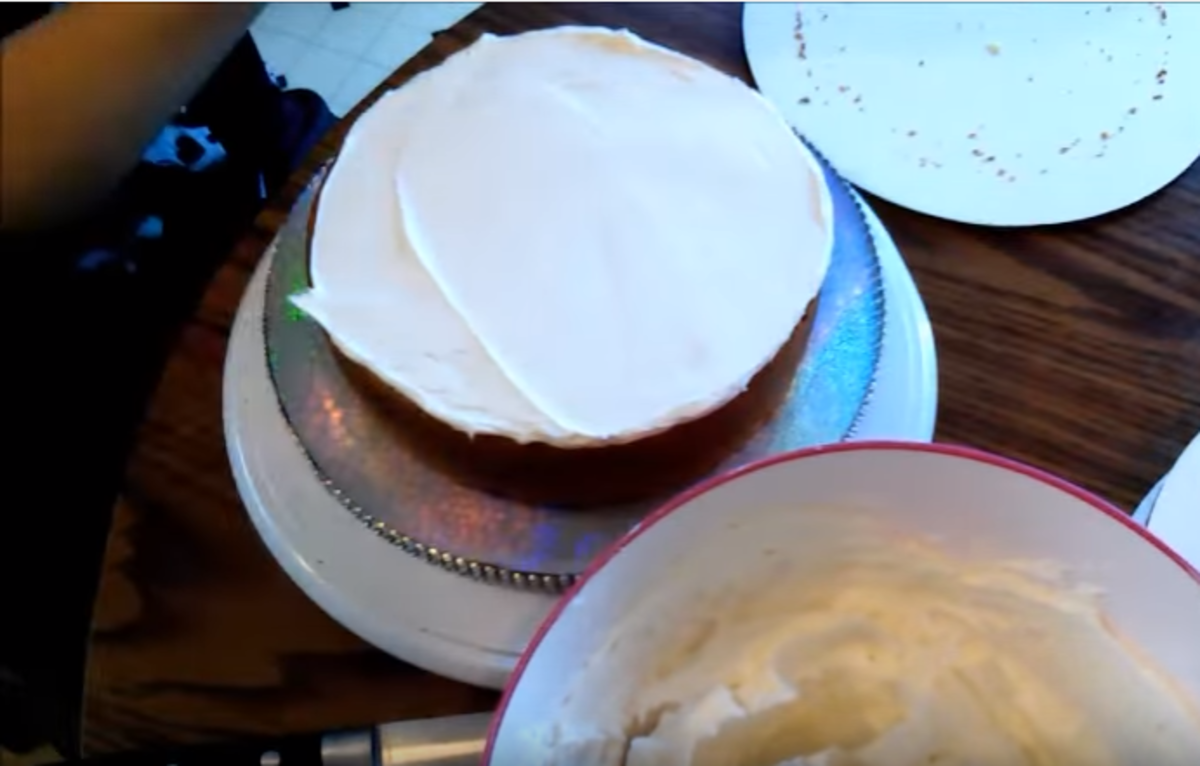 Spread the frosting evenly along the entire top of this layer.