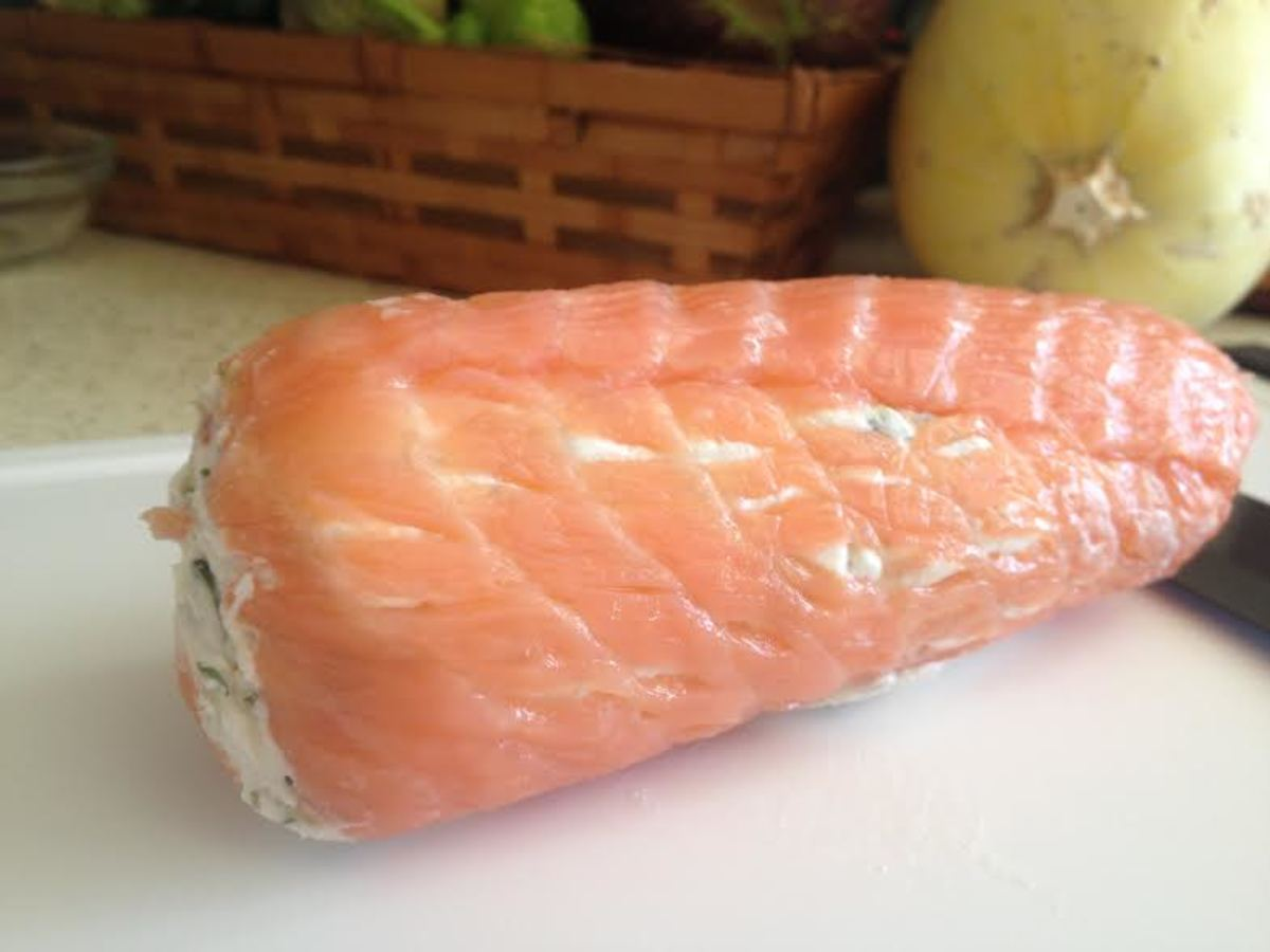 Remove the salmon roll from the refrigerator and take it out of the plastic wrap.  It is ready to slice!