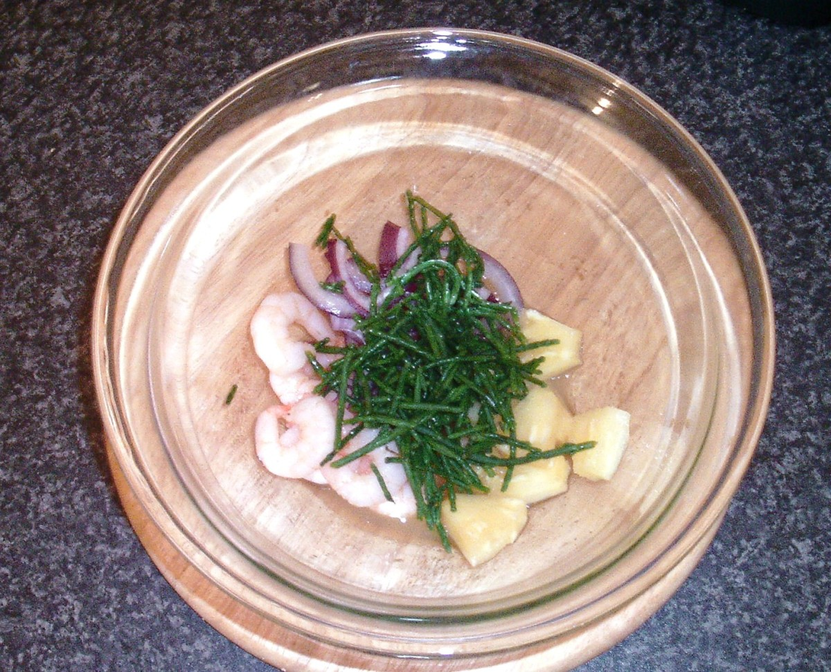 Samphire is added to salad tossing bowl