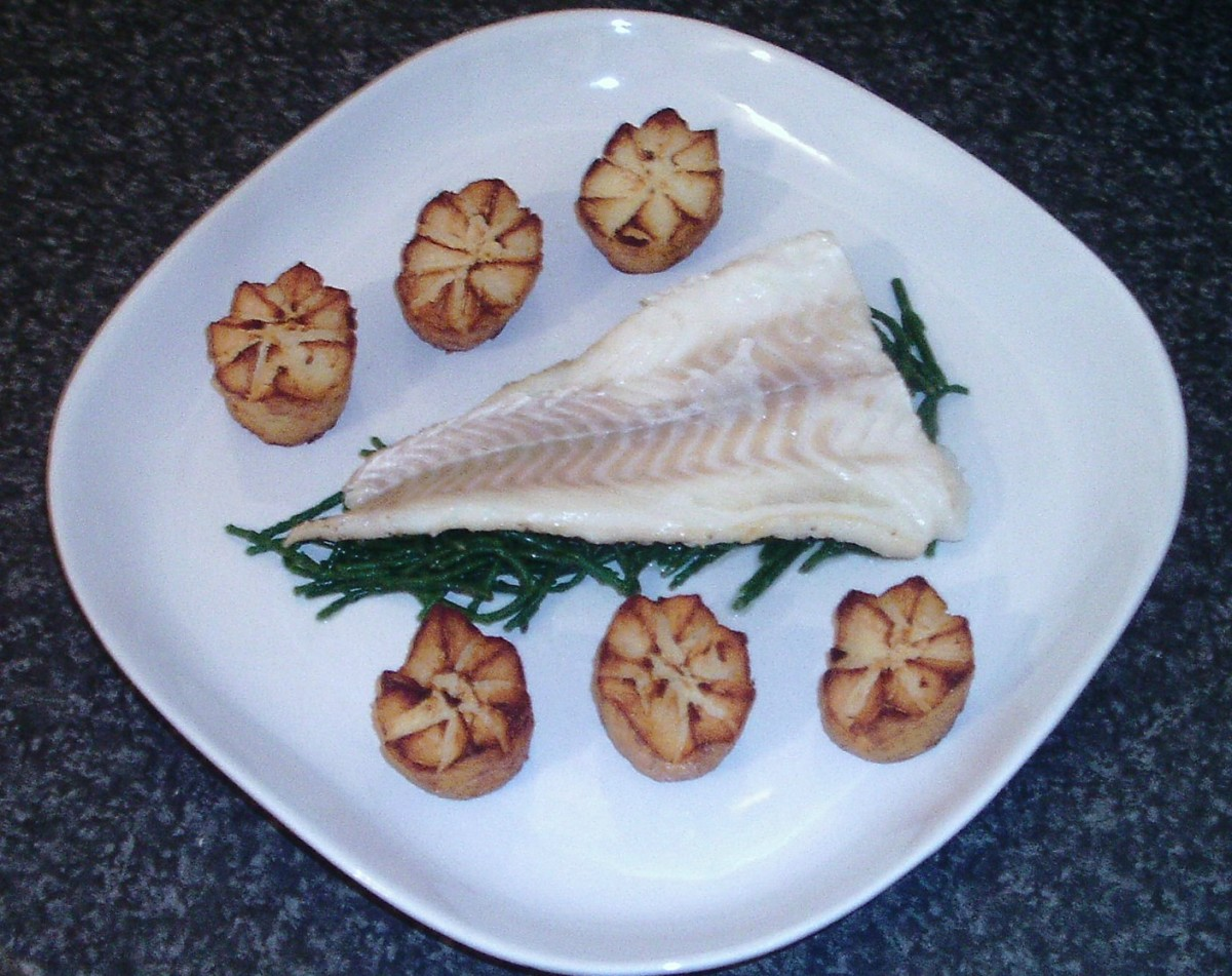 Potato crowns are arranged either side of cod