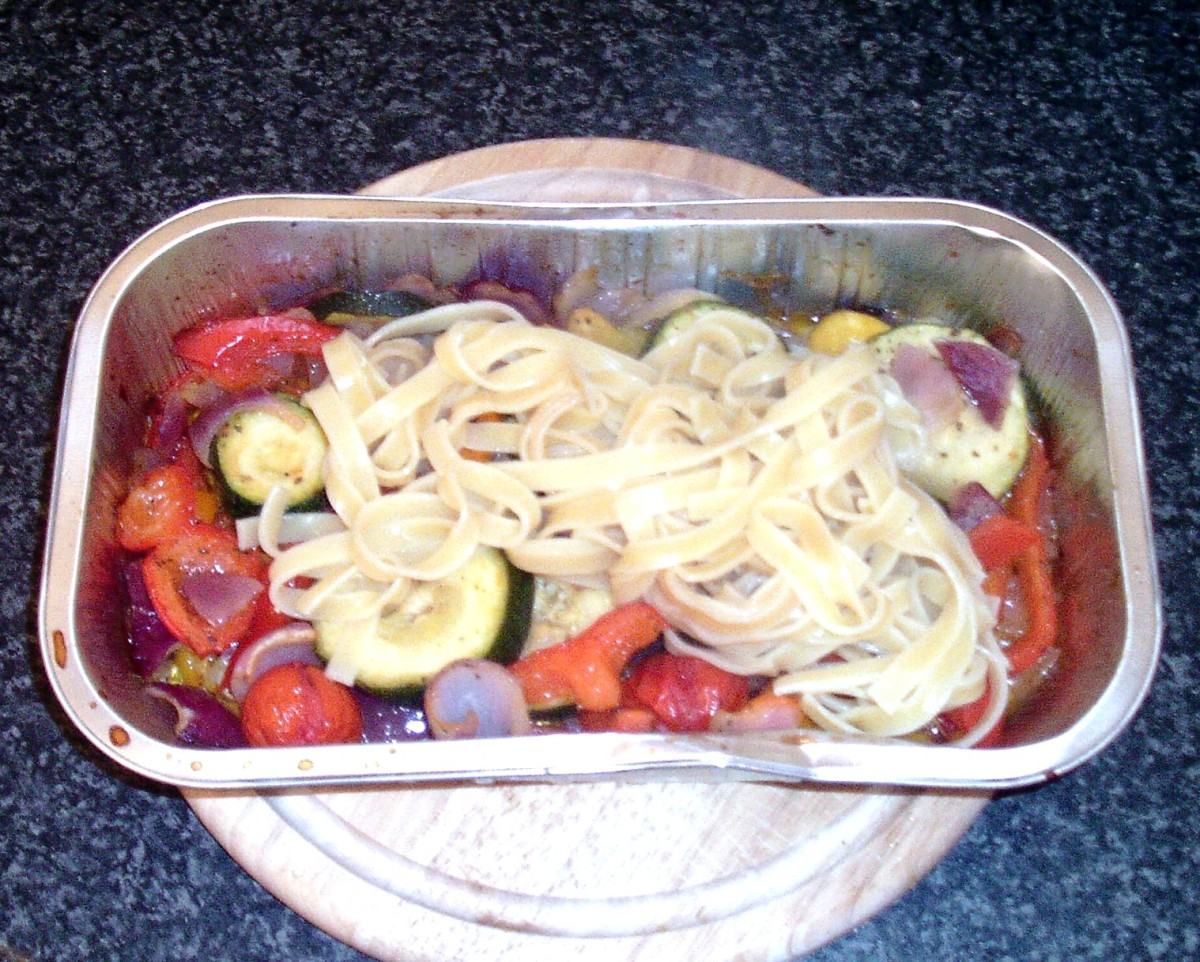 Tagliatelle is added to tray of vegetables