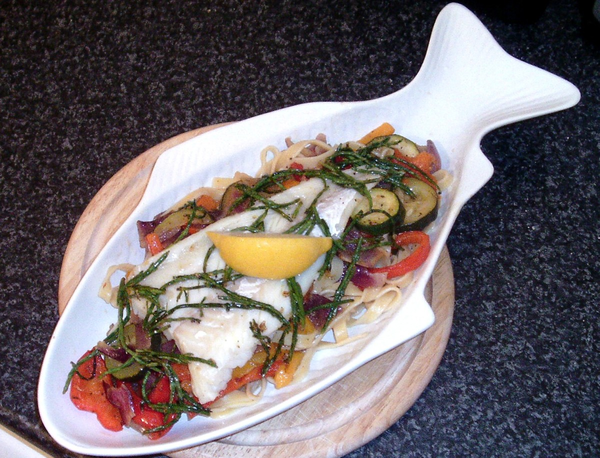 Cod fillet on mixed roasted vegetables with samphire sauteed with garlic
