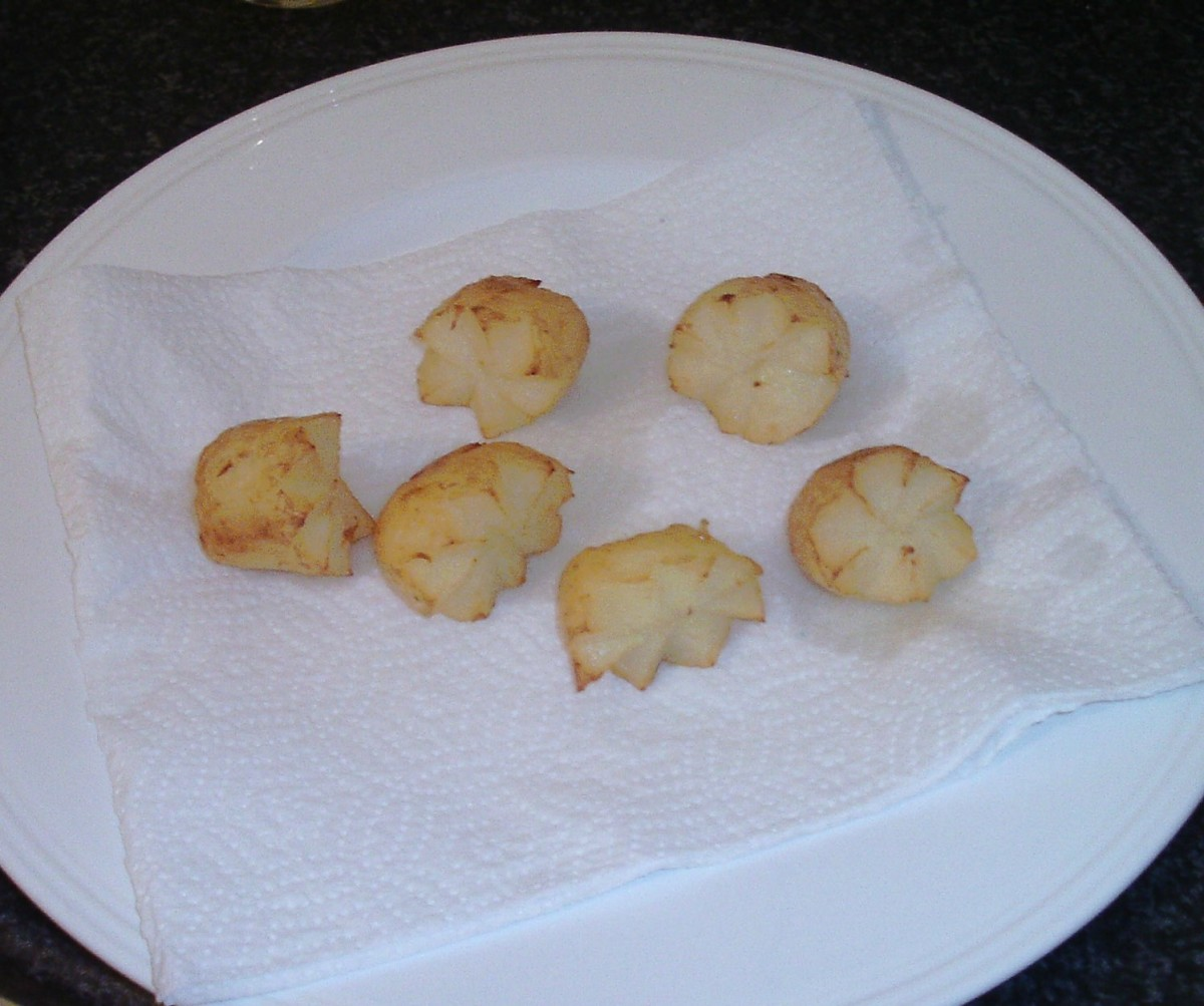 Potato crowns are drained on kitchen paper and left to cool