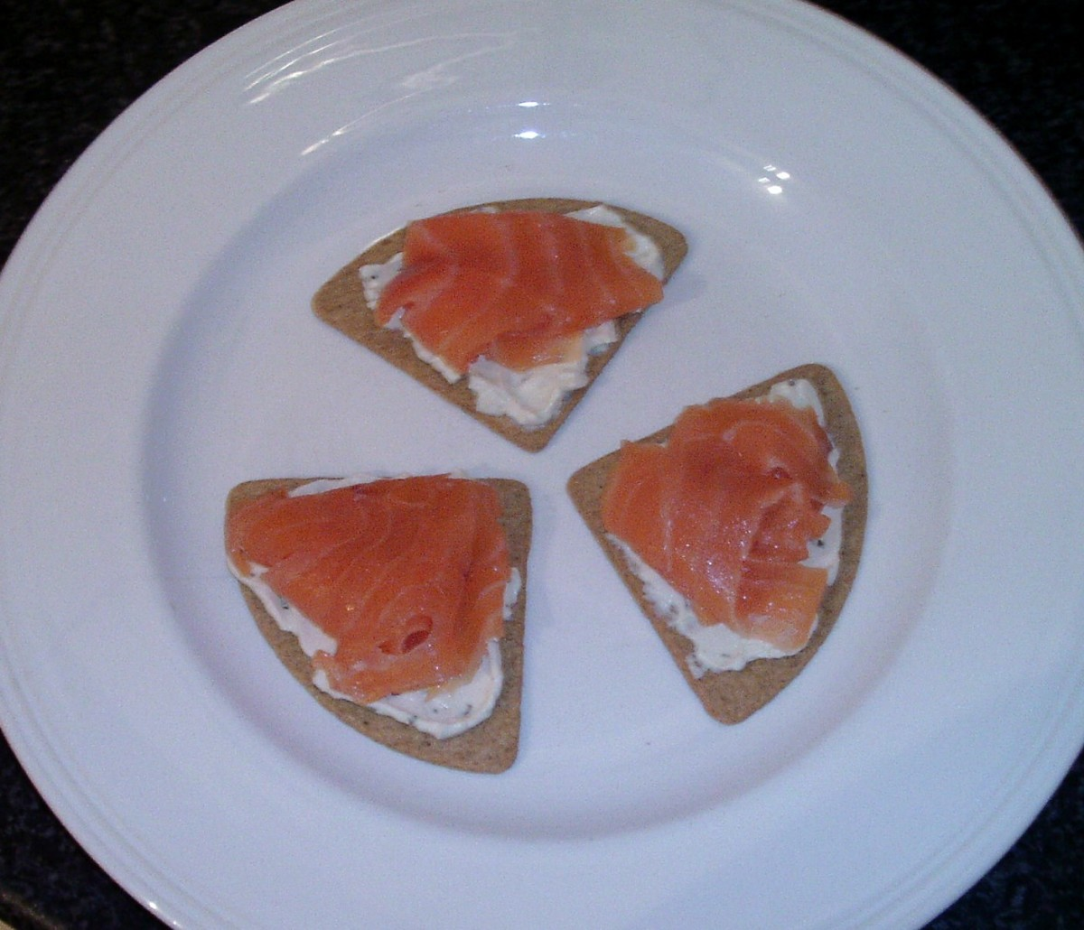 Smoked salmon is laid on oatcakes