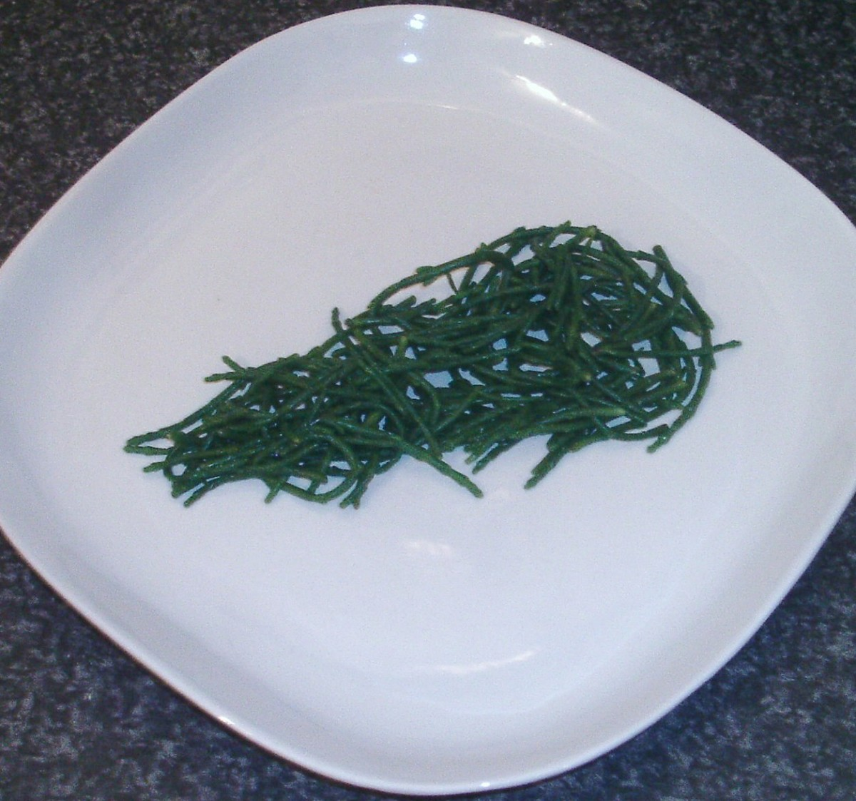 Samphire is arranged as a bed for cod
