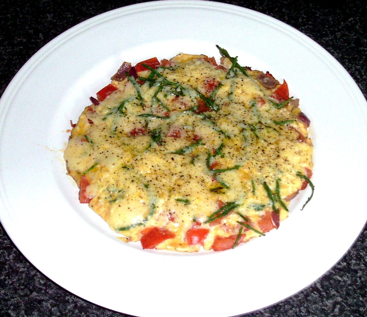 Samphire is made to garnish and season a tomato and red onion tortilla