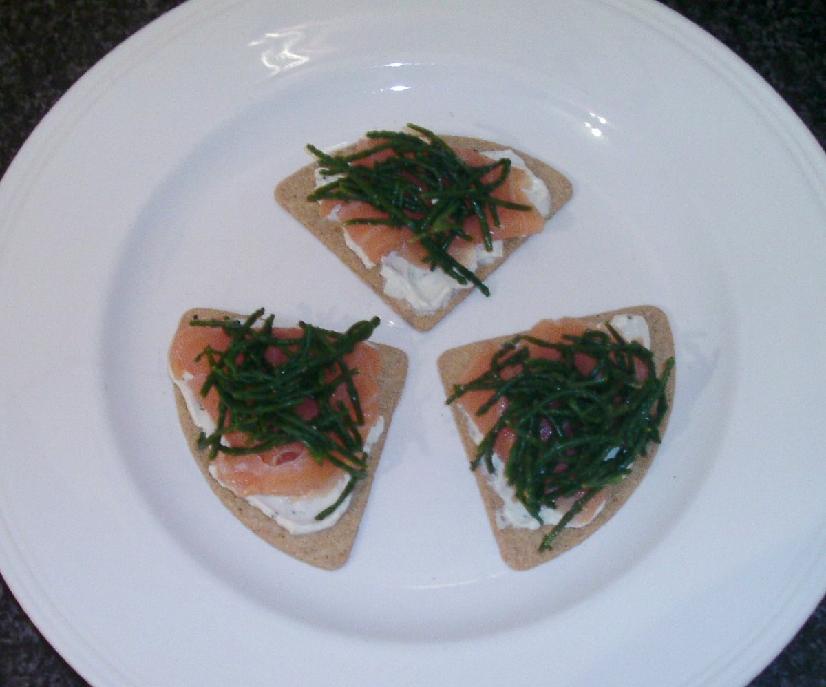 Cream cheese is spread on Scottish oatcakes before being topped with smoked salmon and samphire