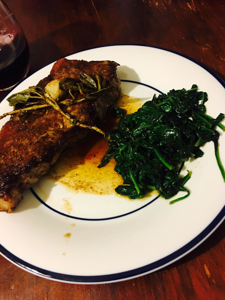 pan-seared-new-york-strip-steak-with-garlic-and-sage-butter-and-wilted-red-pepper-spinach