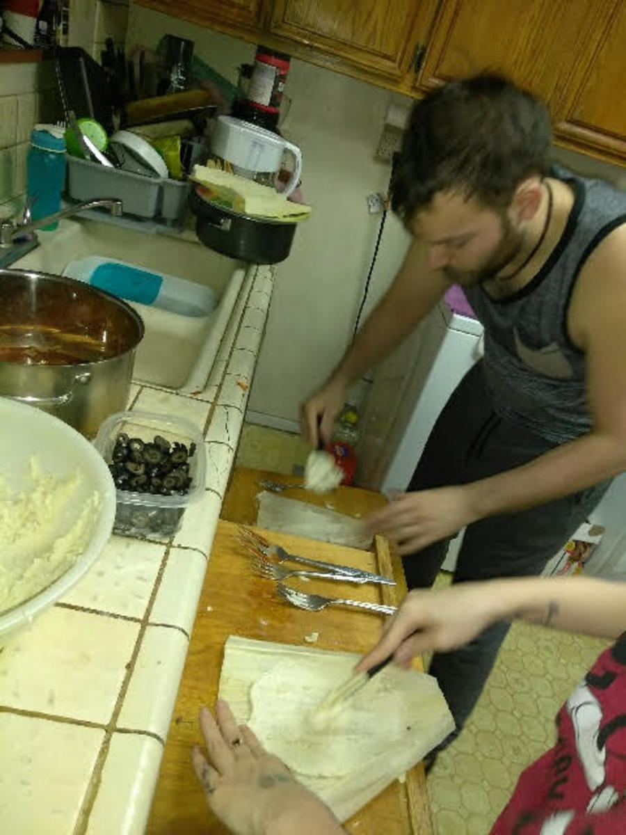 The kids get involved in the tamale-making process.