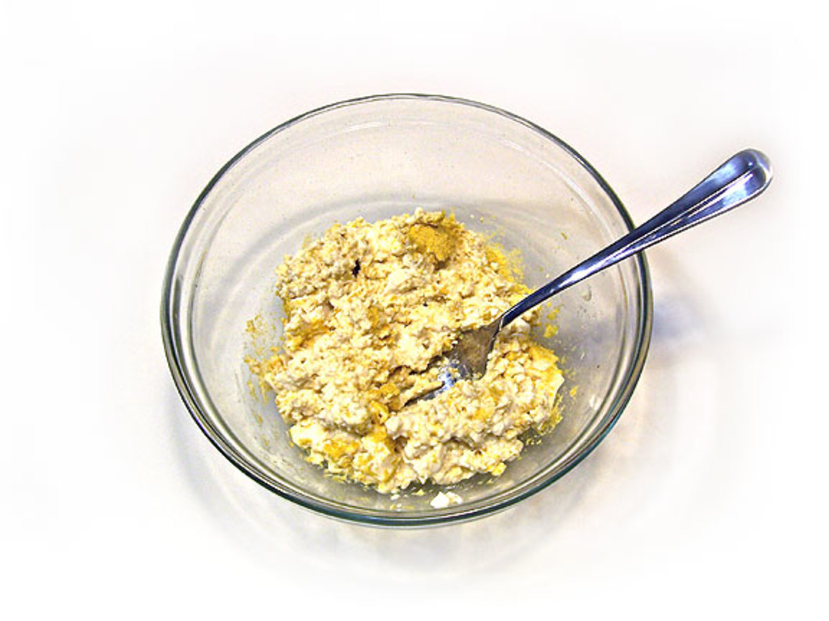 Mash the tofu and nutritional yeast with a fork.