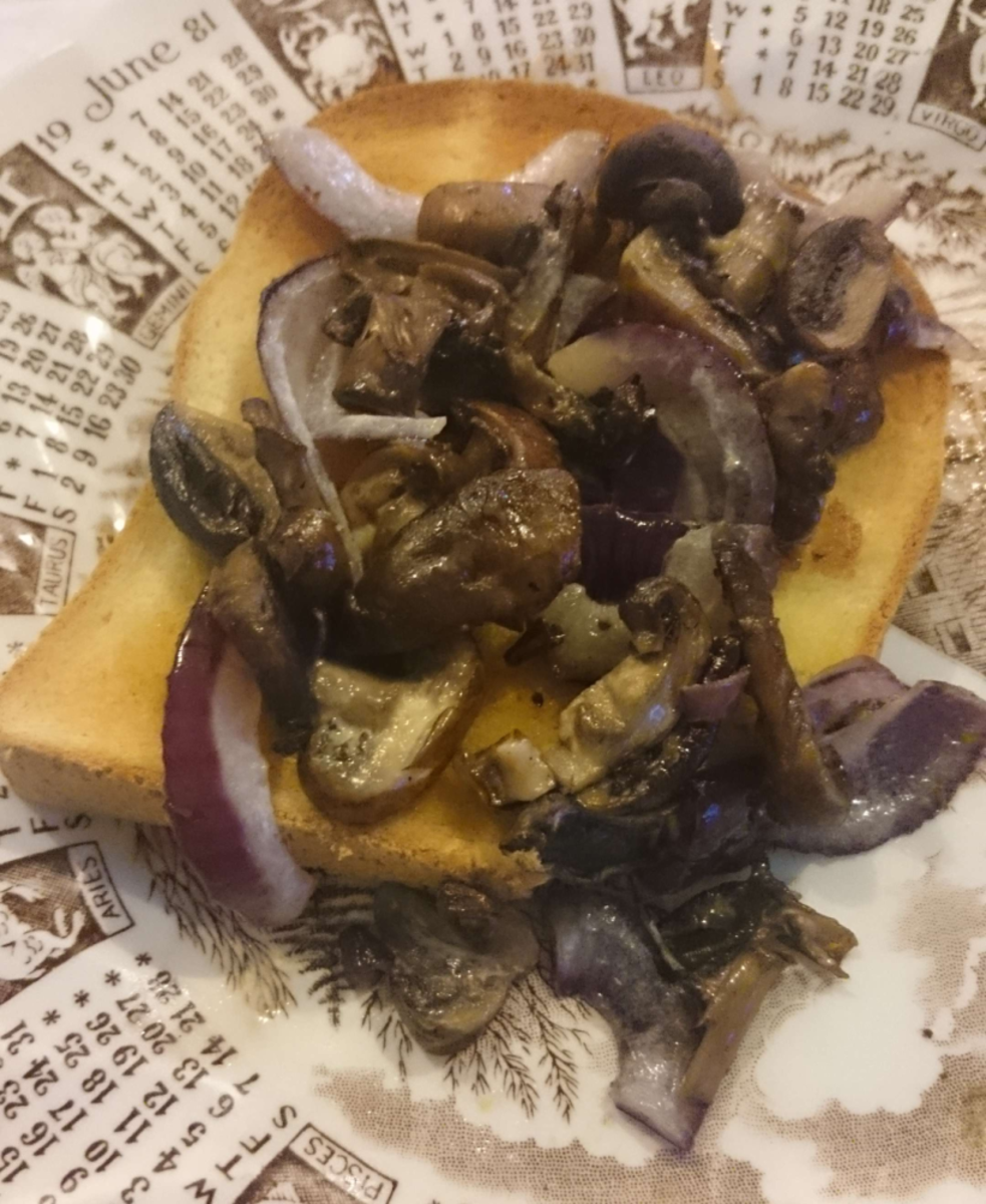 Mushrooms and red onion on toast—a gluten-free and vegan lunch.