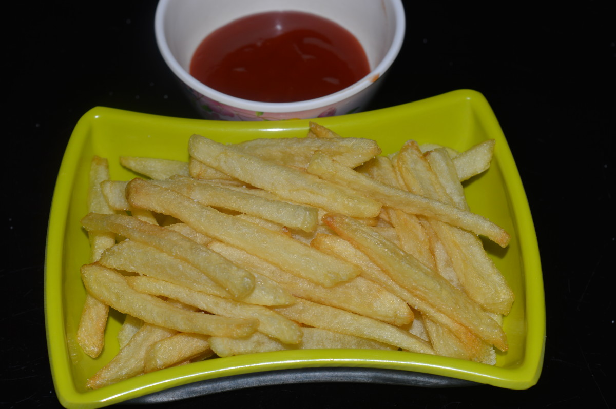 Homemade French fries served with tomato sauce