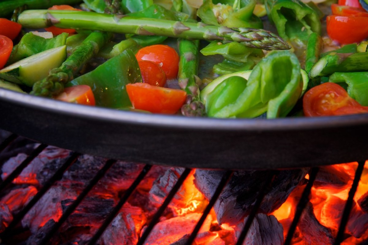 Cook vegetables on the grill in your paellera