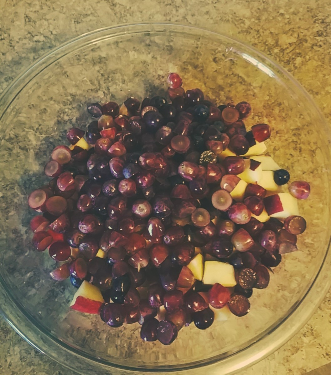 Put the grape halves into the mixing bowl.