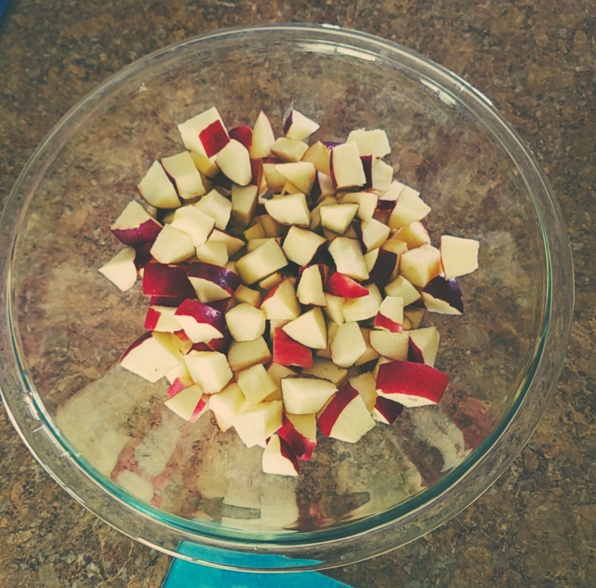 Put apple pieces in a large mixing bowl.