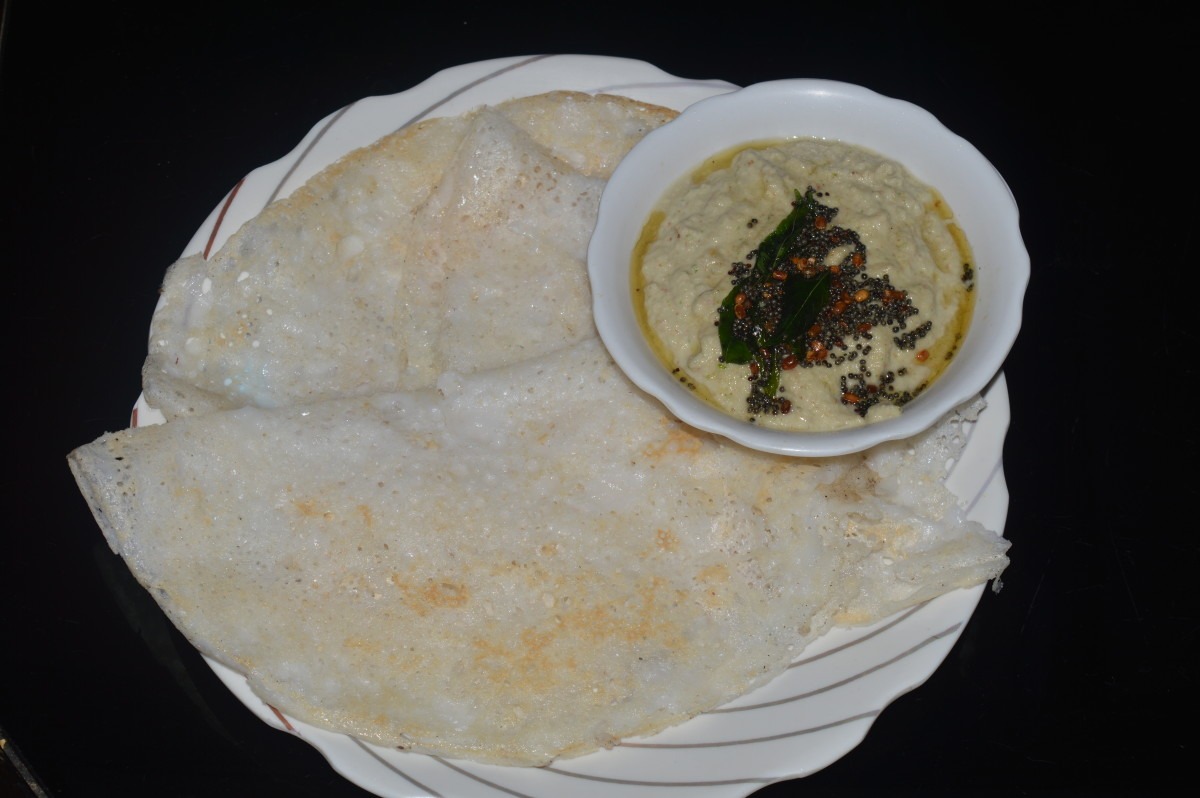Thin rice crepes (Neer dosa) are served with peanut chutney.