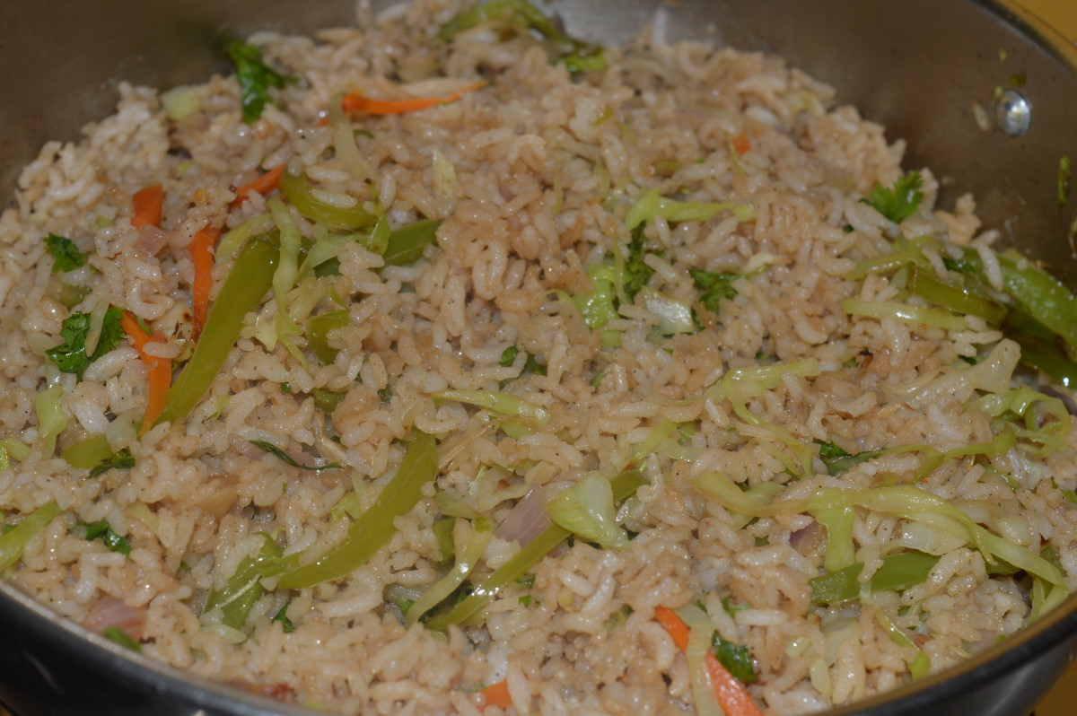 finishing stages of cabbage fried rice