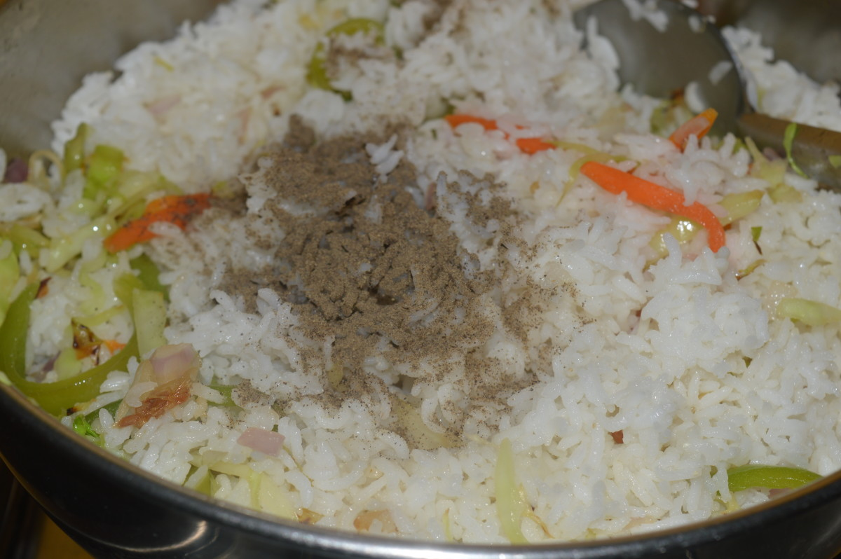 cooked rice, pepper powder, and salt added