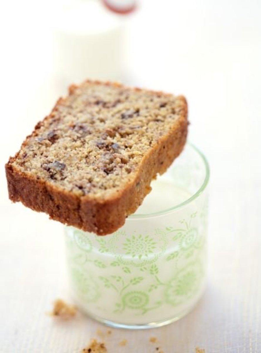 A slice of quinoa banana bread goes with milk.