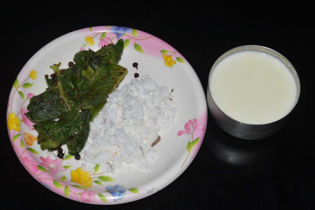 Step three: Grind oregano leaves mix, grated coconut, and curd