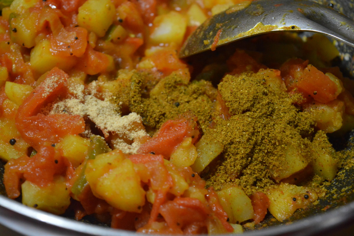 Step four: Add coriander powder, red chili powder, garam masala powder, dry mango powder, turmeric powder, and salt.