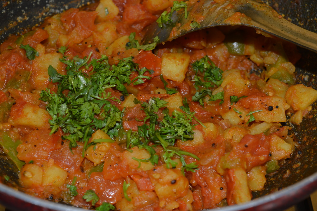 Step five: Combine the spices with the veggies. Add sugar(optional) and chopped coriander leaves. Mix.