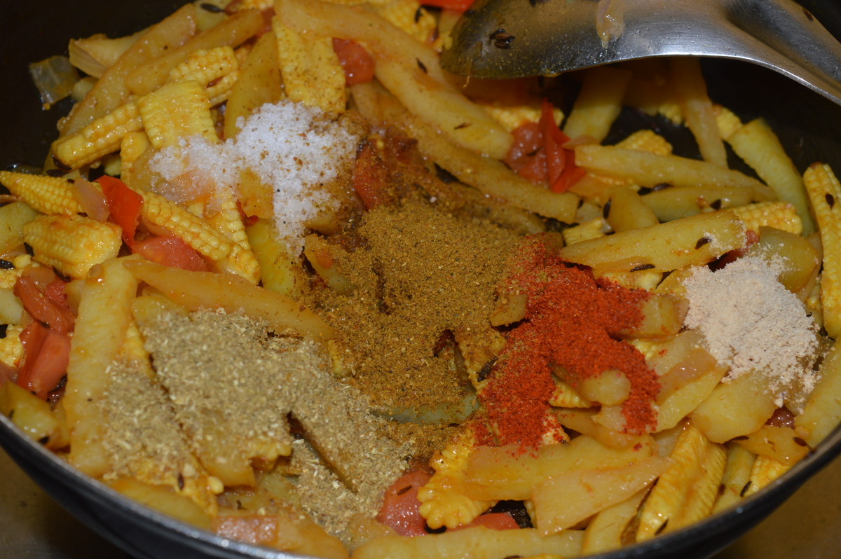 Add all the spice powders, and salt. Mix well.