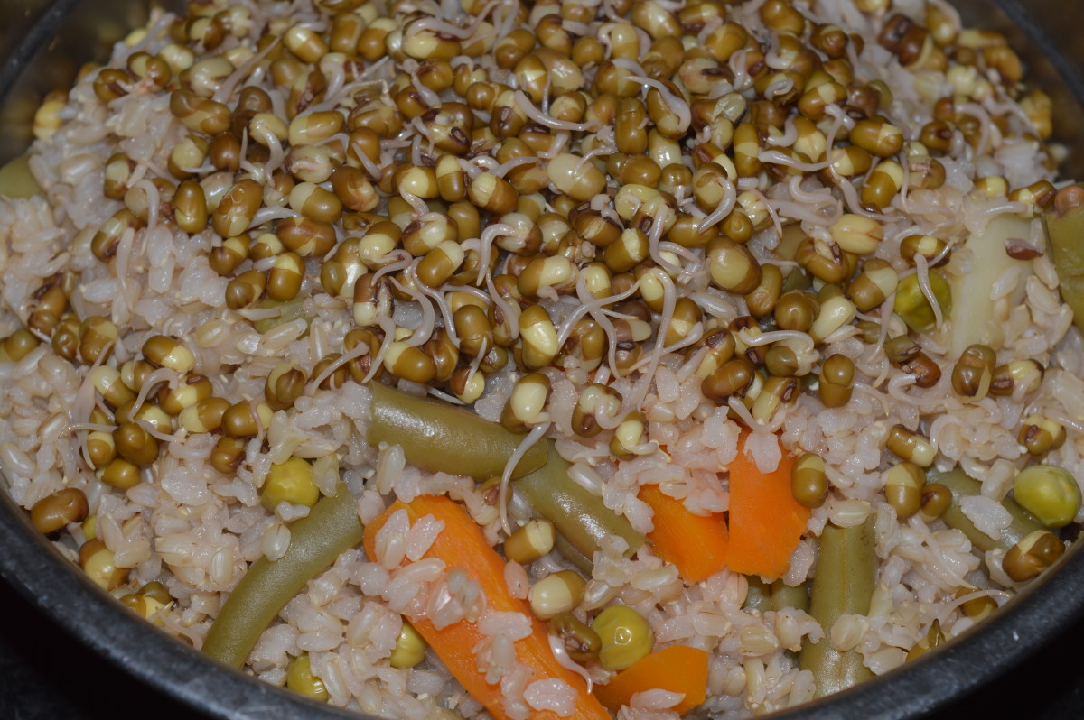 Step two: Cook for 5 minutes after a whistle. Turn off the fire. By now, brown rice cooks nicely with mung beans and the veggies.