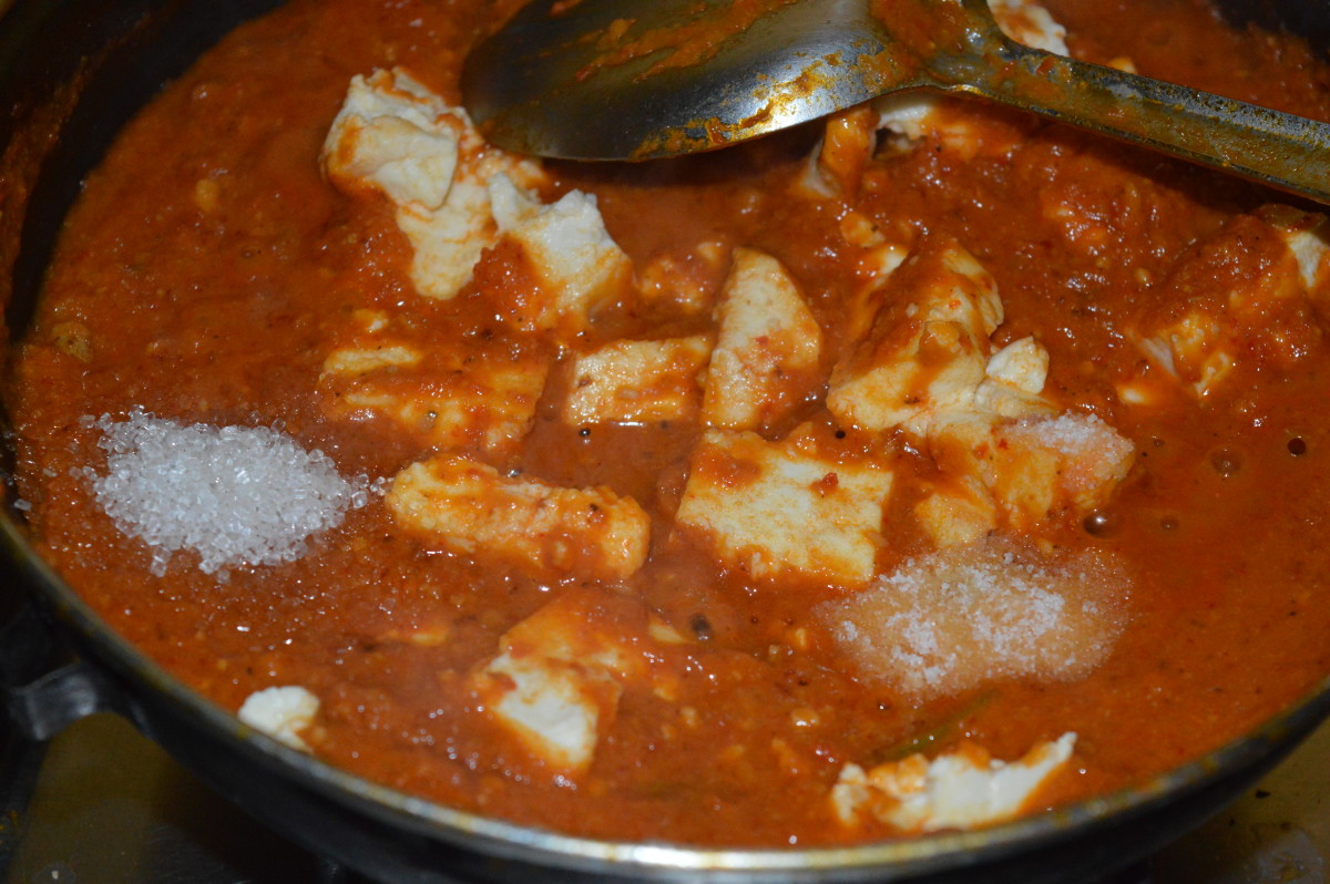 Step five: Pour some water and boil the gravy. Add sugar and salt. Also add paneer cubes. Simmering continues.