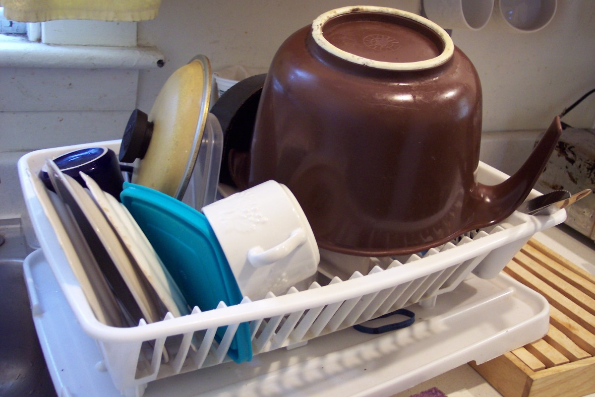 Luxury: Lots of kitchen equipment AND a dishwasher. More likely: No dishwasher; no clean second whatever in the cupboard. Just washing, reusing, and piling everything in the dish drain.