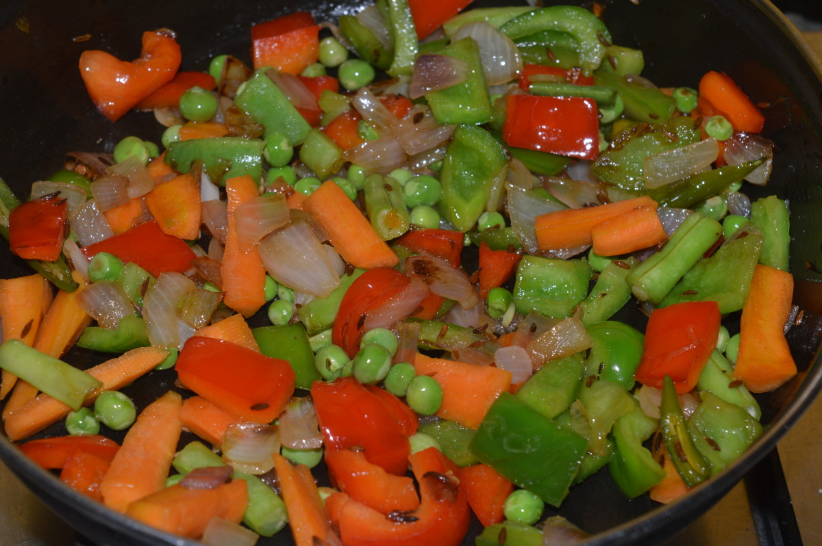 Step five: Saute cumin seeds and onion in oil. Add all the vegetables and cook for 5 minutes on low fire.