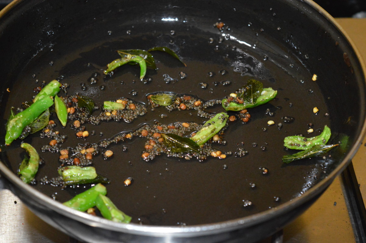 Step two: The tempering made by sauteing mustard seeds, white lentil, green chilies, hing, and curry leaves.