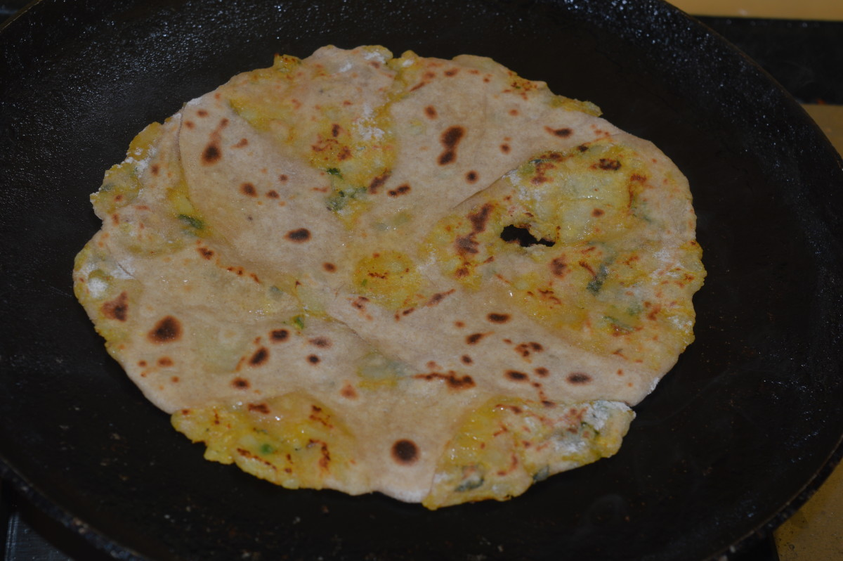 Step seven: Cook it on a hot pan, adding some oil or ghee