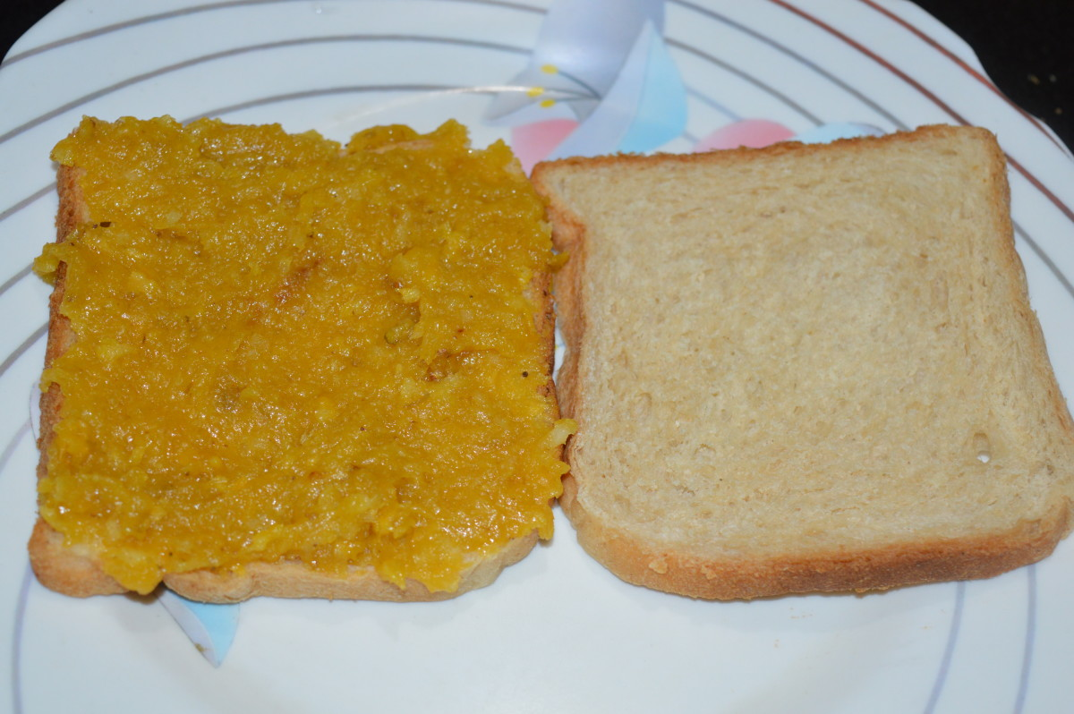 Step seven: Spread half portion of the paste on a bread slice. Place another slice on it to make sandwich.