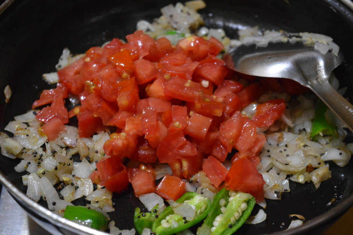 Step four: Add chopped tomatoes. Cook till they are mushy