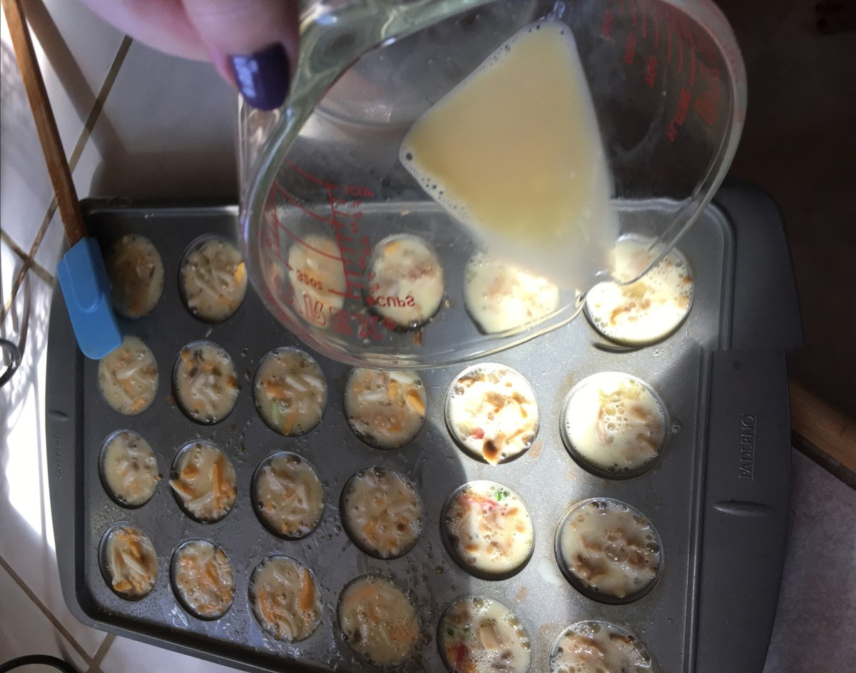 Pour eggs into each cup in the muffin tin and you are ready to cook.
