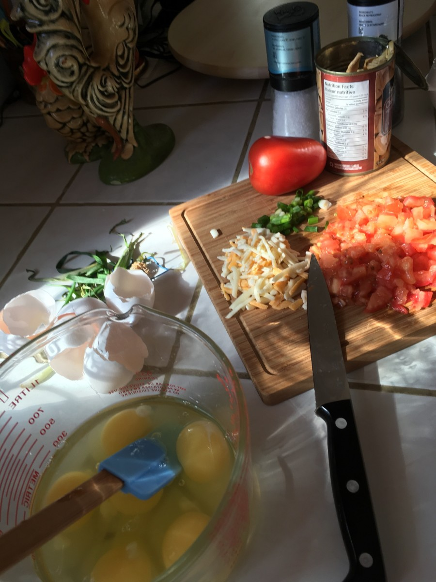 Chopping up all the ingredients. Add all vegetables and cheese.