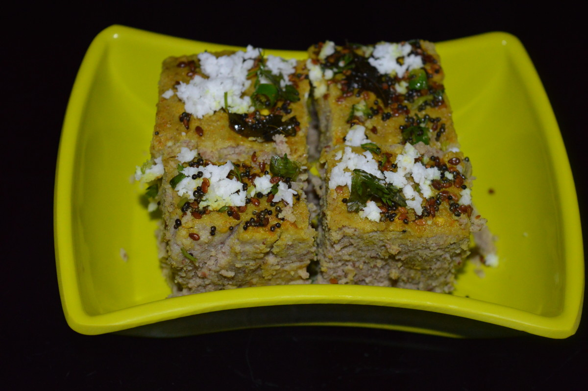 Multi pulses dhokla is ready to serve! Serve with a spicy and a sweet chutney/sauce. Enjoy the taste!