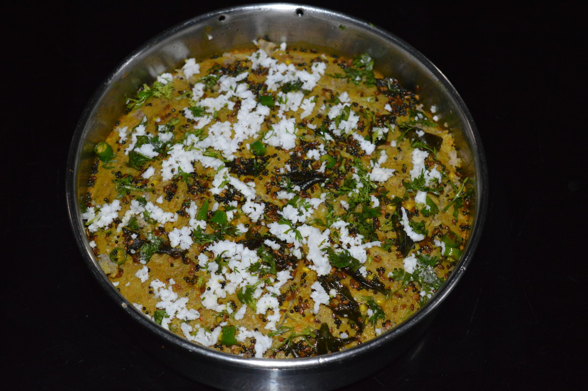 Step eleven: Spread grated coconut and chopped coriander leaves on the top. Cut in desired shape and size.