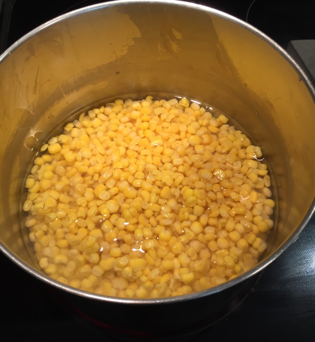 Just cover the corn with water and bring to a boil