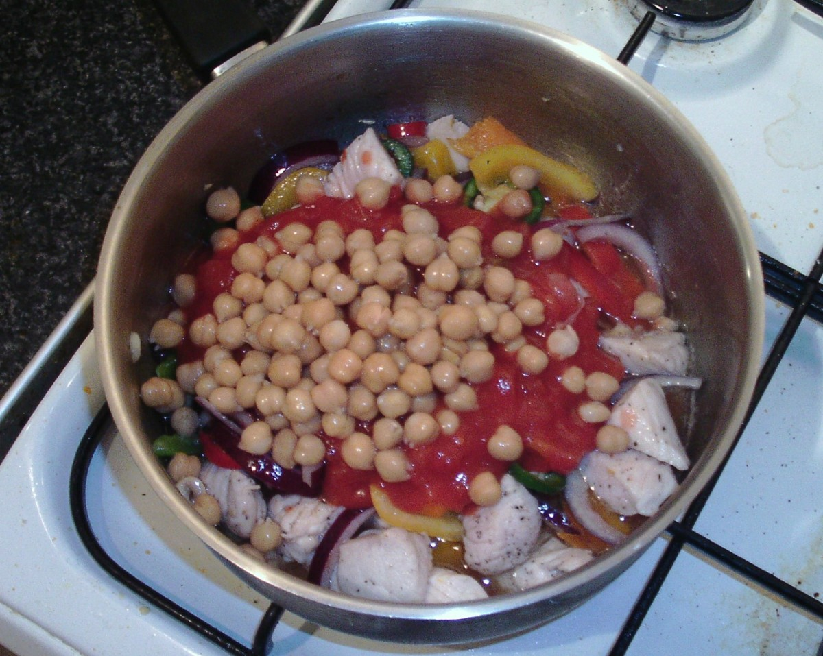 Tomatoes and chickpeas are added to pot