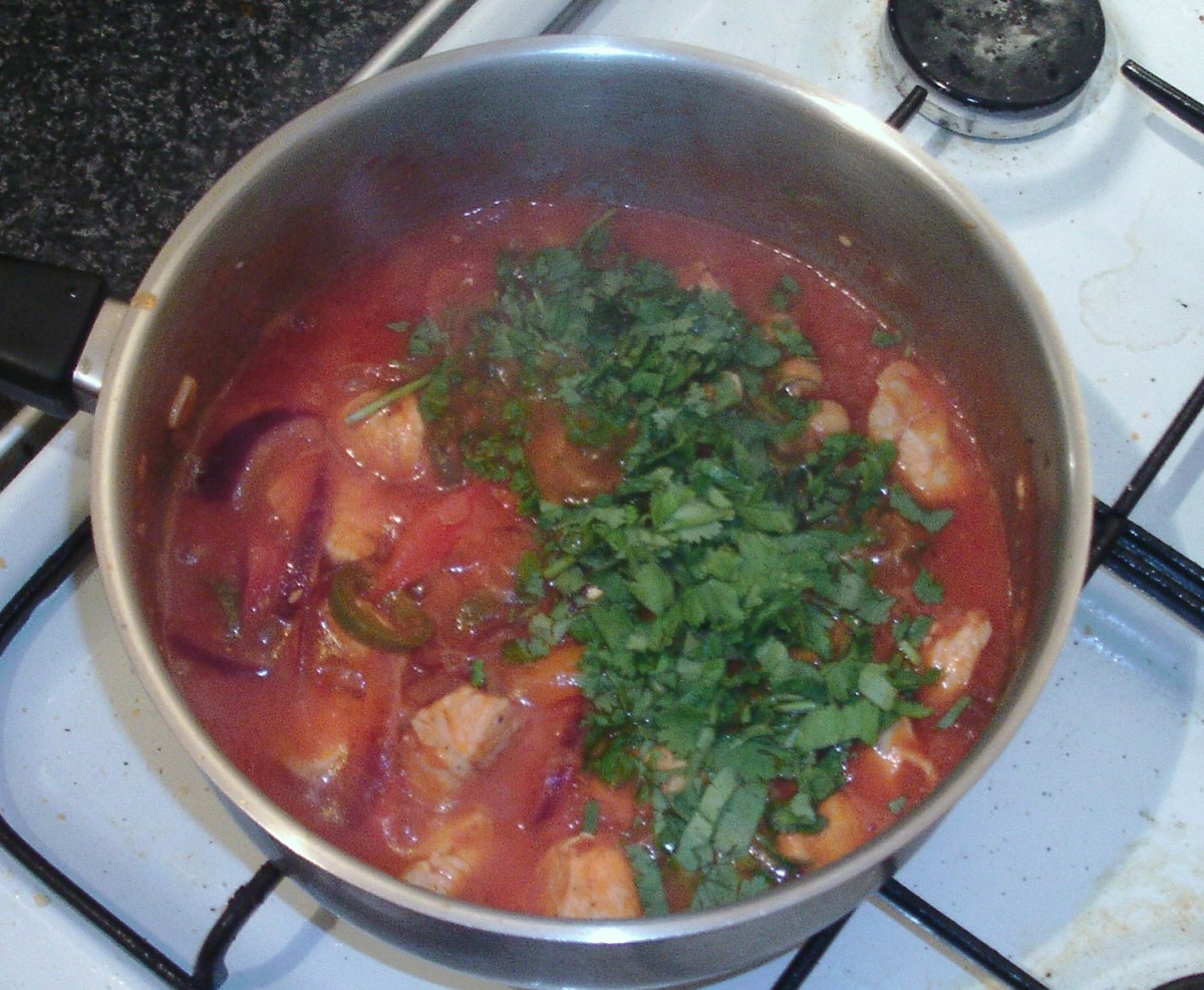 Chopped coriander is added to chicken stew