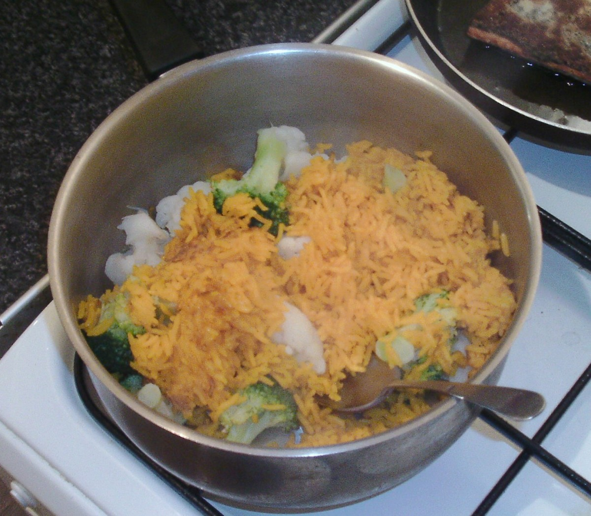 Broccoli and cauliflower are stirred in to rice