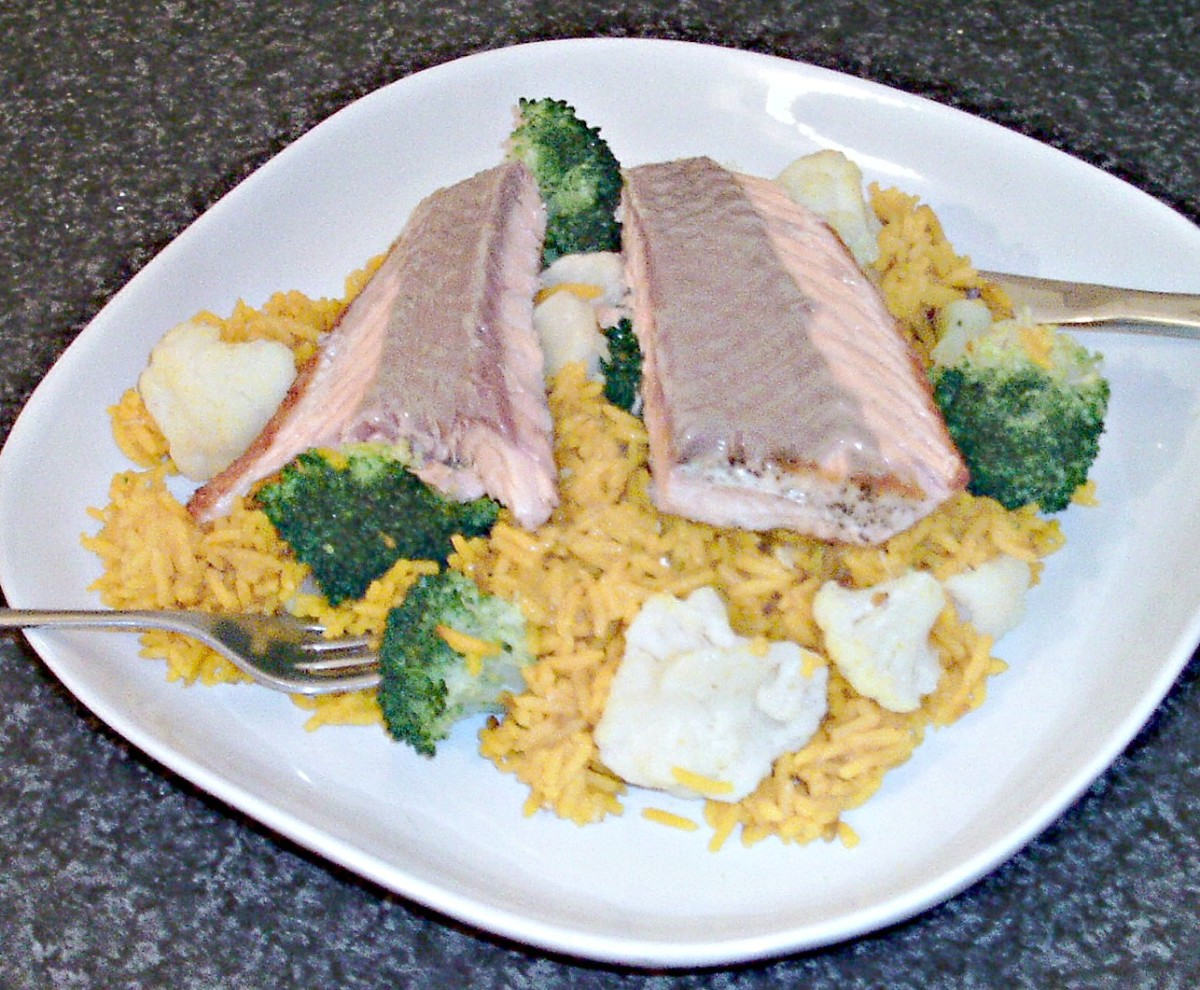 Enjoying salmon with broccoli and cauliflower turmeric rice