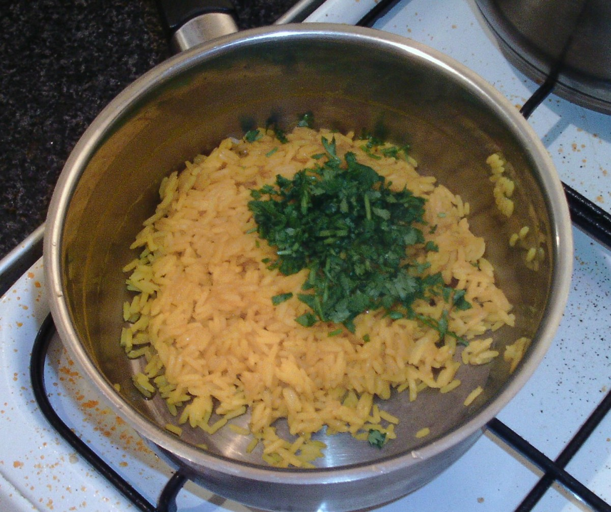 Chopped coriander is added to turmeric rice