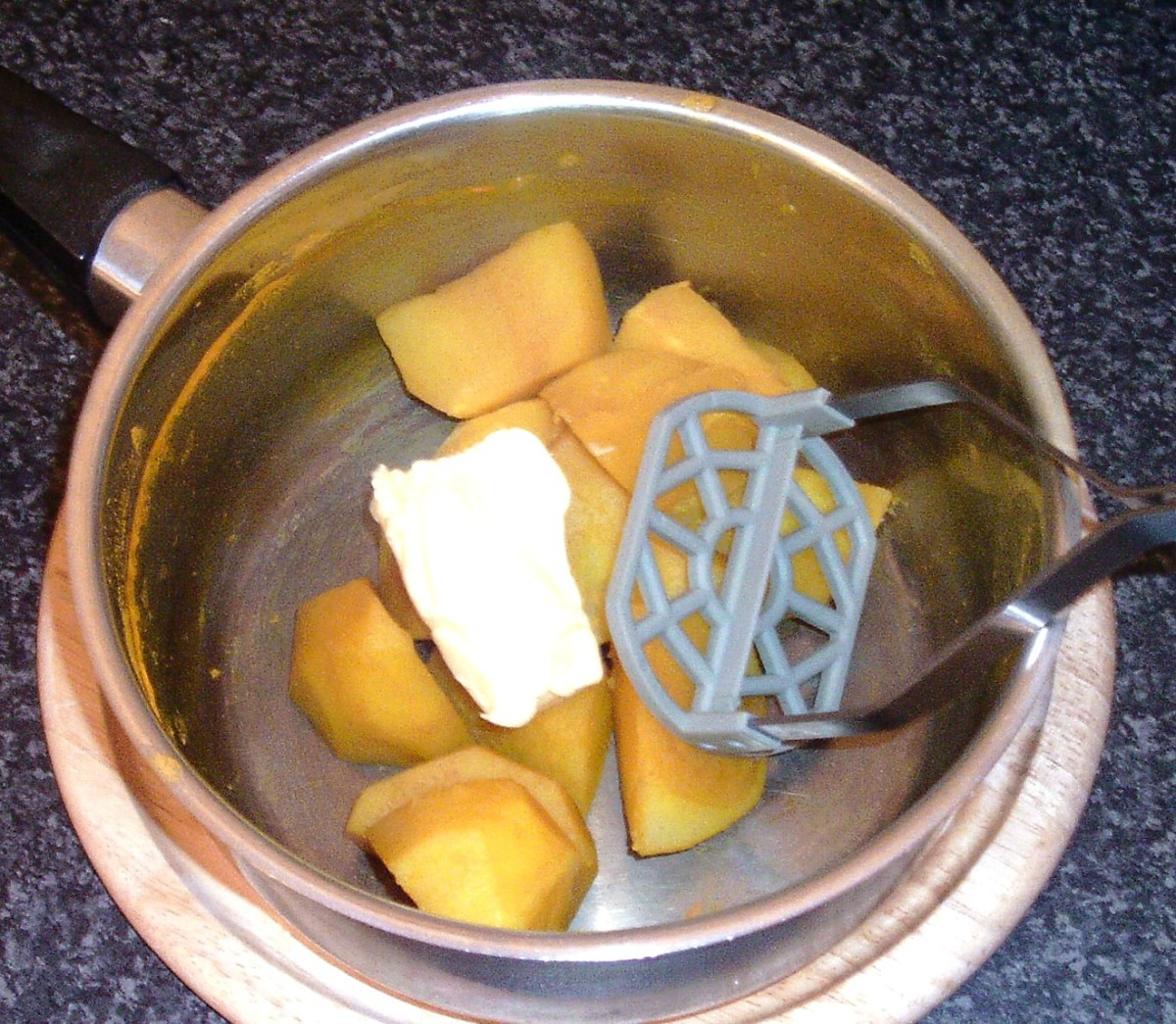 Turmeric potatoes are mashed with butter
