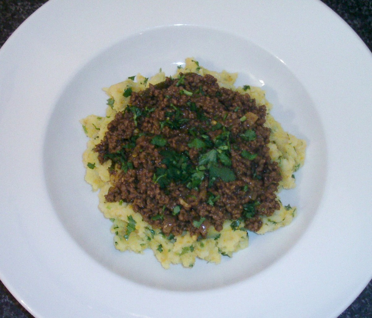 Curry and chilli spiced beef on a bed of turmeric mashed potatoes
